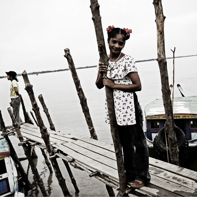 At the pier in Bani Shanta , teenaged sex-workers are waiting for customers coming by boat. Bani Shanta is a 600 or 700 hundred populated port village in Pashur river and more than half of the residents are sex-workers, making the life of the village dependant on prostitution job.
