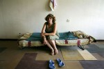 A newly arrived internally displaced person from Garedzvari village of Gori district -- Nana Muradashvili, 37 -- stays at a former Soviet military compound in Tbilisi, the capital of Georgia, as Russian troops continue to occupy large parts of the country. Aug 18, 2008.