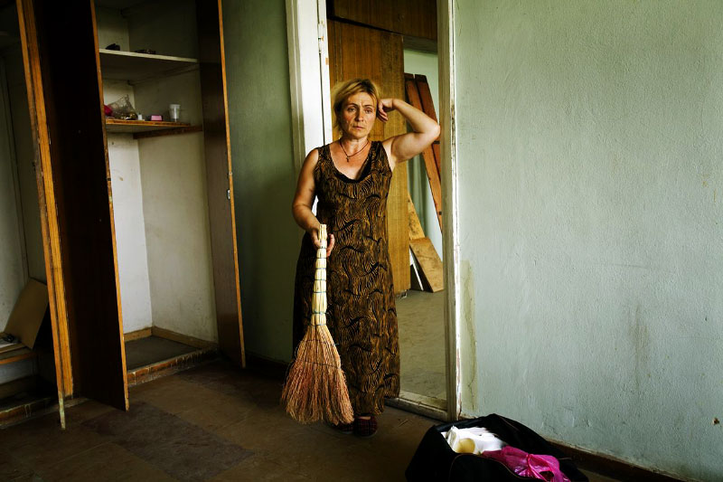 A newly arrived internal displaced person from Tskhinvali in South Ossetia -- Leila Babucidze, 47 --, stays at a former Soviet's military compound in Tbisili, the capital of Georgia, as Russian troops  still occupies a large part of the country. Aug 17 2008.