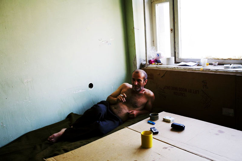 A newly arrived internally displaced person from Gori district -- Temur Meskhidze, 47 -- stays at a former Soviet military compound in Tbilisi, the capital of Georgia, as Russian troops continue to occupy large parts of the country. Aug 18, 2008.