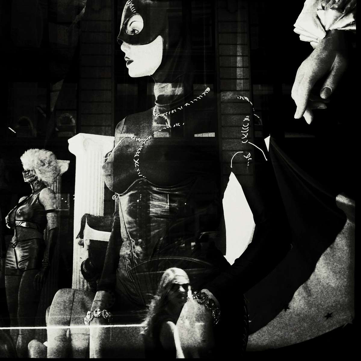 A passerby woman is overlapped with a window display of mannequins, due to New York's summer reflection. #newyork #refulection #mannequin #window_display