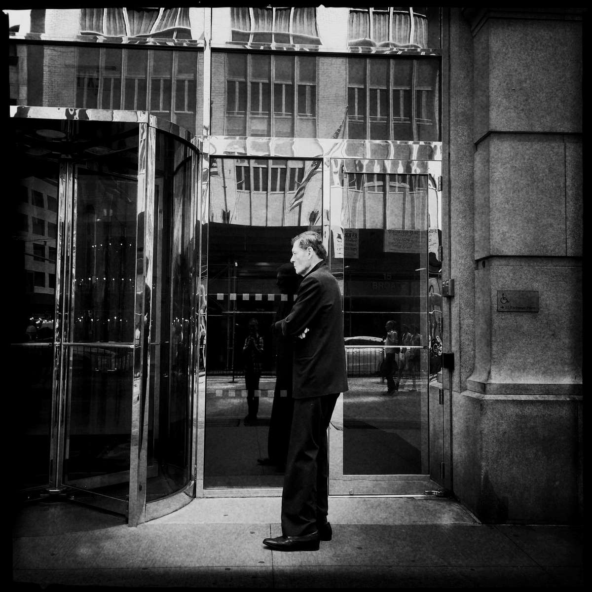 A musing security man near Wall Street, New York.