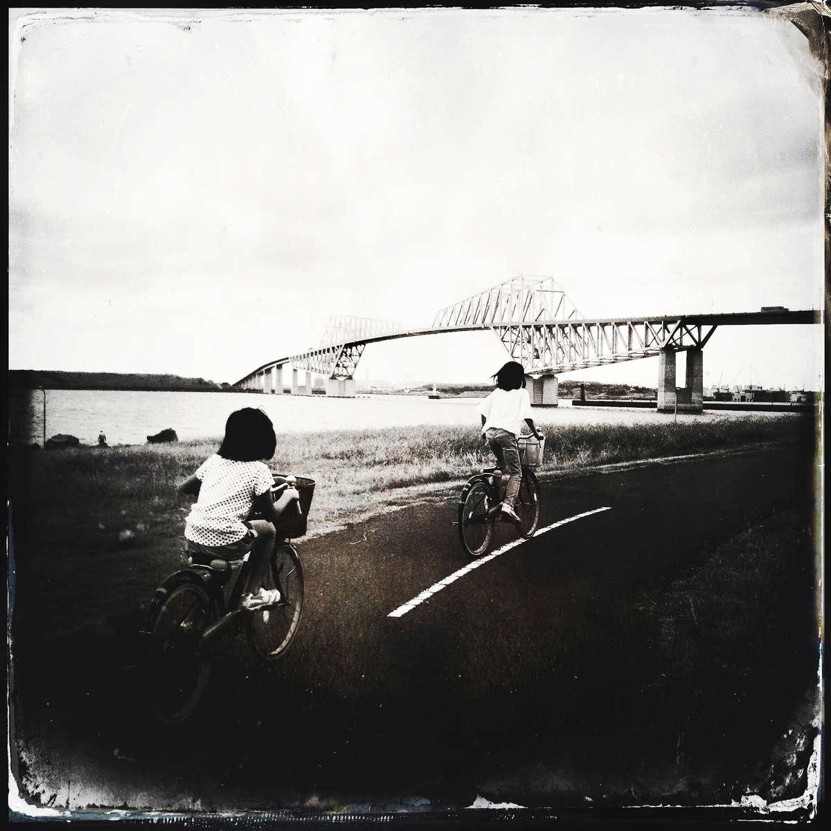 Children on bicycles near Tokyo Gate Bridge. #tokyo #latergram