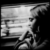 A woman in ennui at a New York subway train bound for Harlem and Bronx.