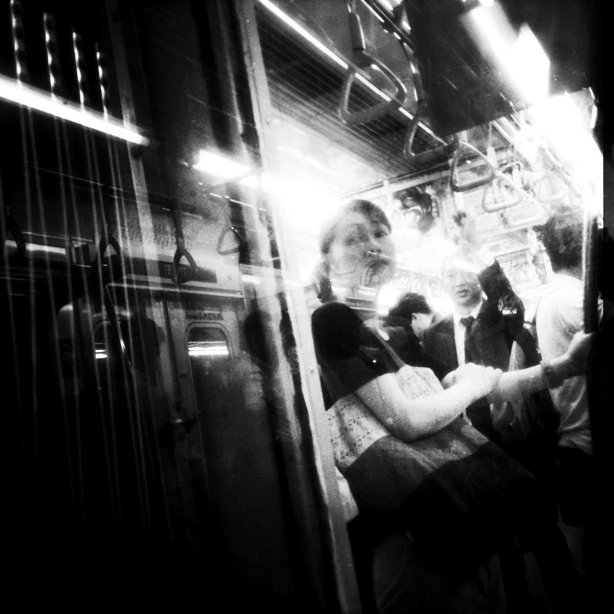 Tokyo ennui: Woman at the metro.
