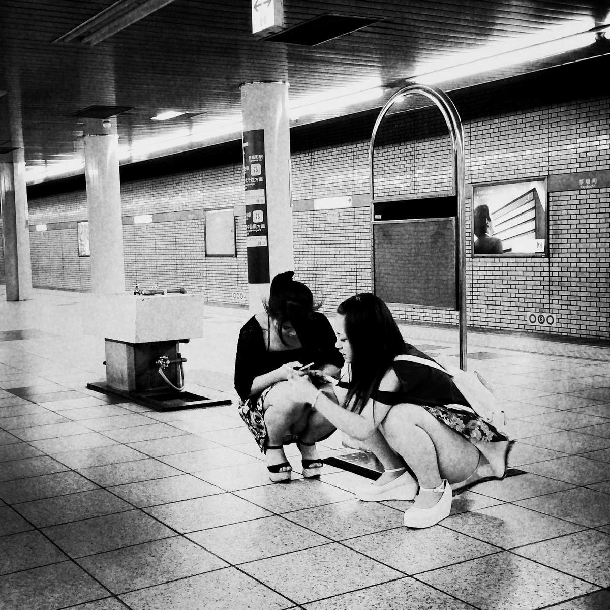 Women at Tokyo Metro at Deep Night