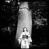 Woman at a holy tree