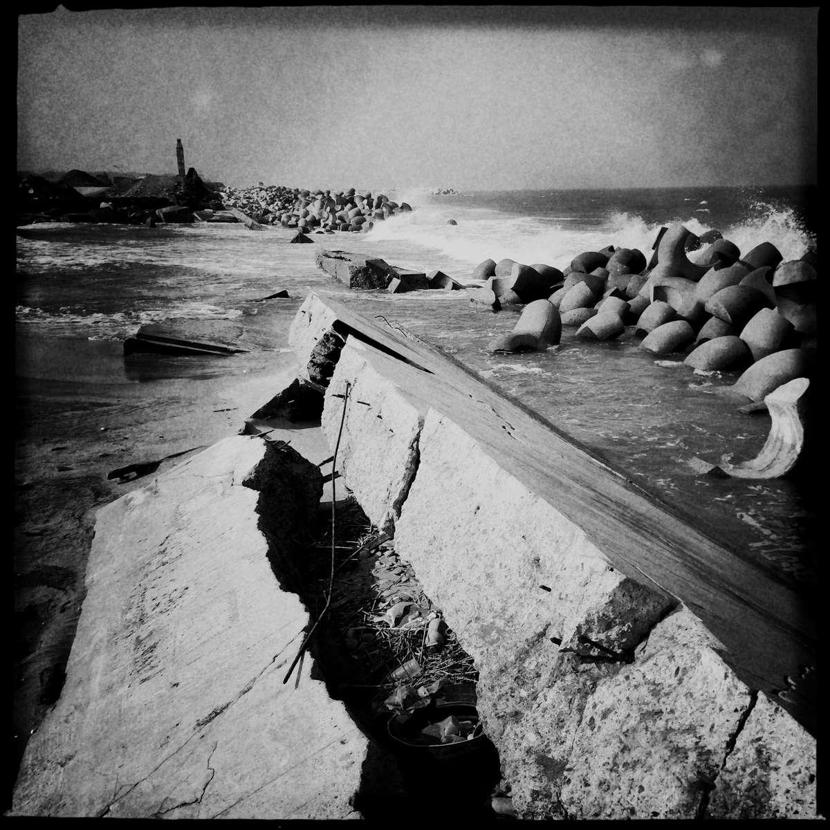 Fukushima:  A broken seawall by tsunami still remains at Odaka, as the 2011 Fukushima nuke power plant disaster continuously and extremely hampers the rebuilding. #fukushima #nuke_radiation #radiation #minami-soma #nuke_power_plant #odaka #broken_seawall #seawall #japan