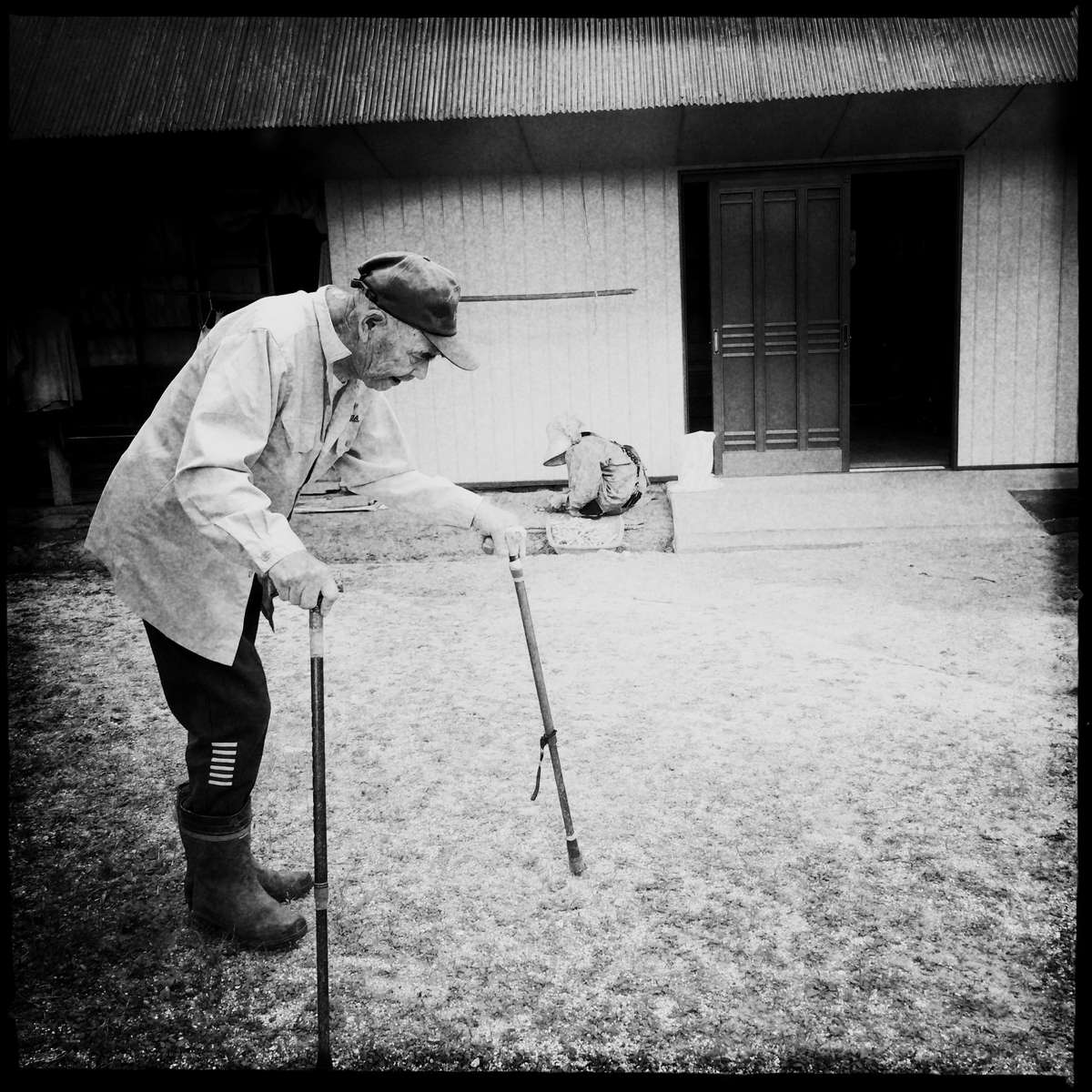 Japan's Nuclear Power Plant Belt: 86 year old handy-capped man practices to move his leg at his house in extremely depopulating Oku-Izumo in Shimane, one of the nuke-plant prefectures in Japan. Meanwhile his wife is peeling peas to help their living. All of nuke power plant regions and nearby have faced the drastic depopulation, the shrinking job market and the aging society. That was one of the biggest reasons nuke reactors were created in such areas, though after the 2011 Fukushima nuke power plant disaster, all reactors have been suspend for the operation. Yet, the Japanese government and many residents of such nuke power plant belt want to resume. #japan's_nuclear_power_plant_belt #old_people #oku_izumo #depopulation #aging_society #shimane #japan #rural_area #countryside #handy_capped