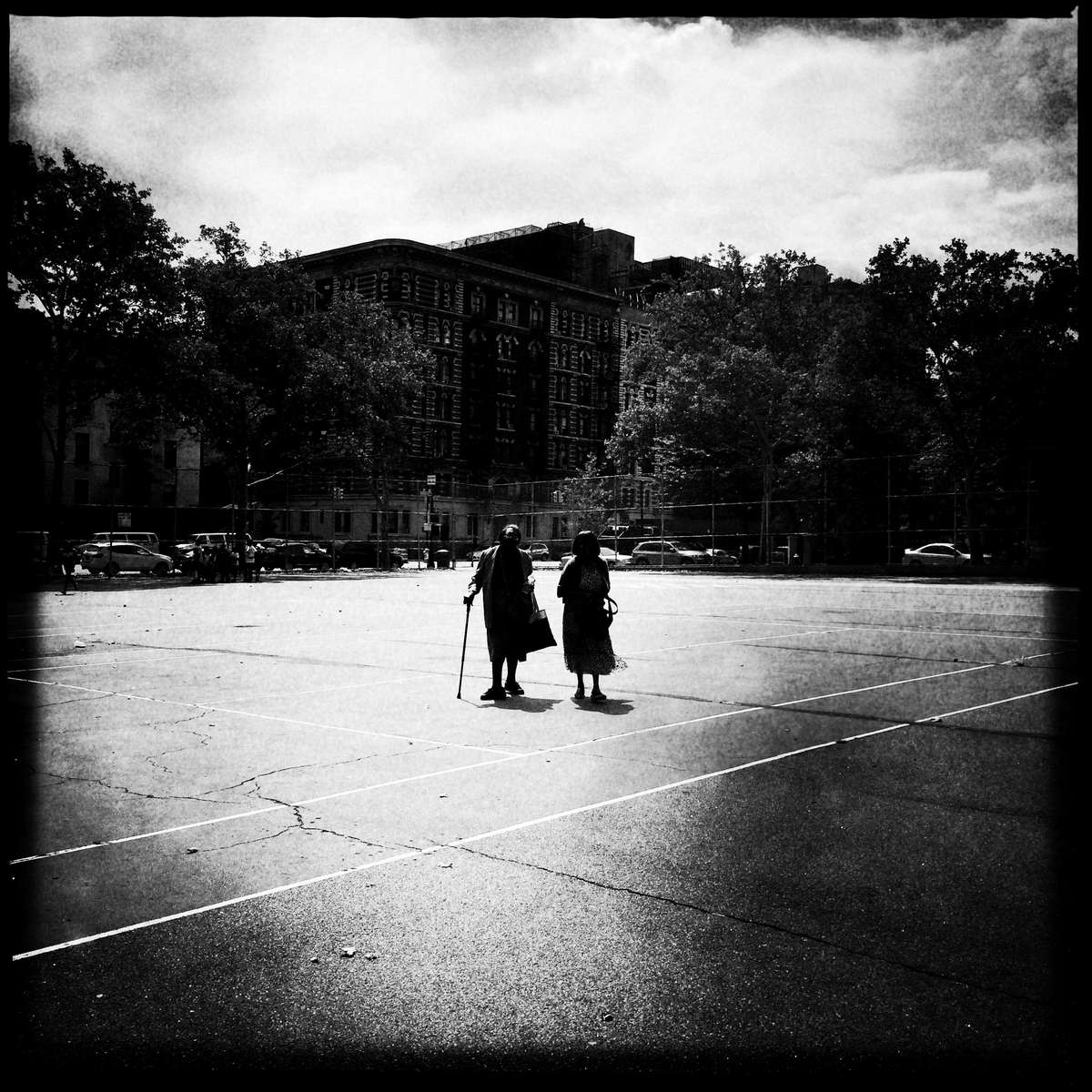 Old ladies walk through a playground in West Harlem in this late hazy morning, as the area is dramatically changing, whether it is redevelopment or gentrification. #old_ladies #women #west_harlem #harlem #playground