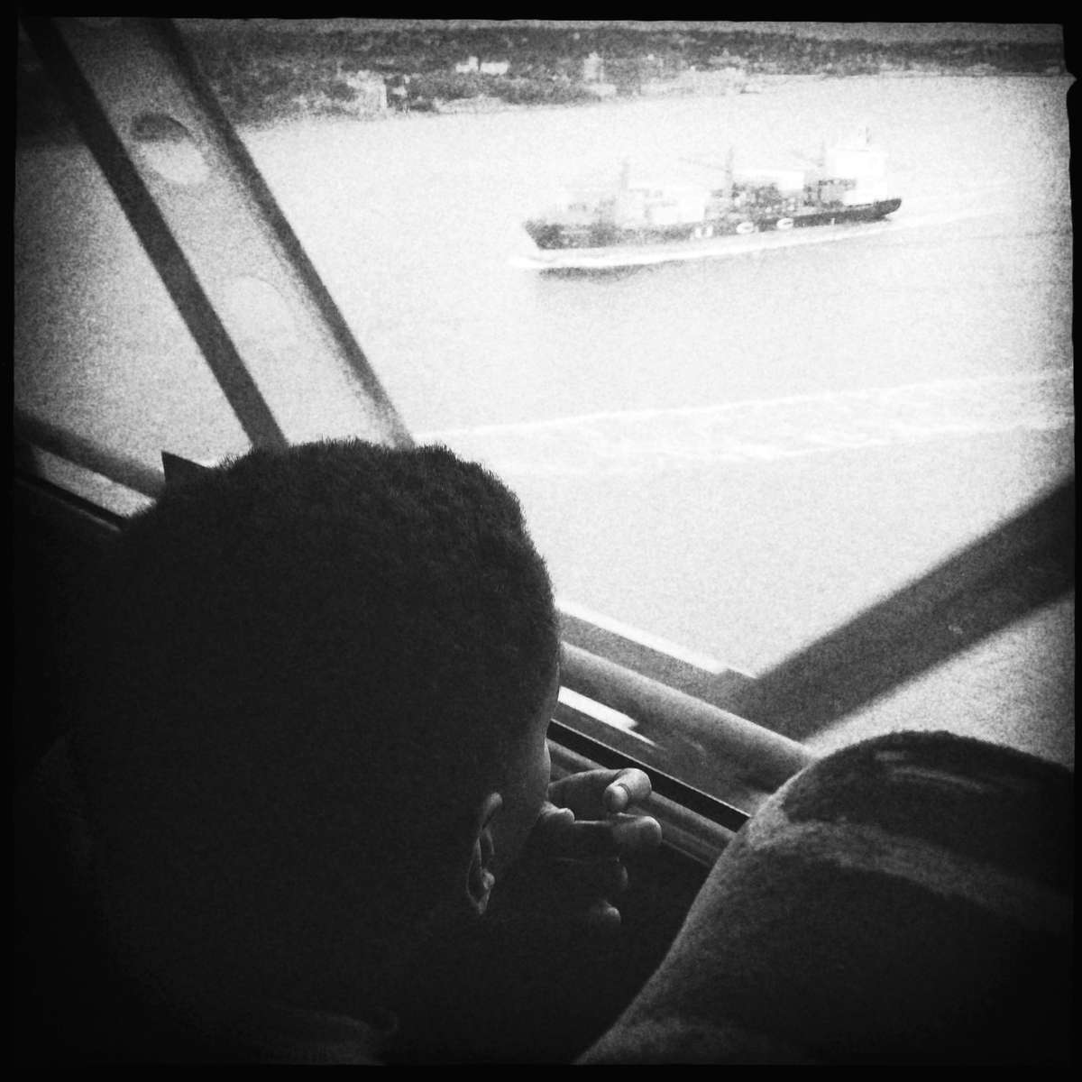 Black Boy looking down at New York Port