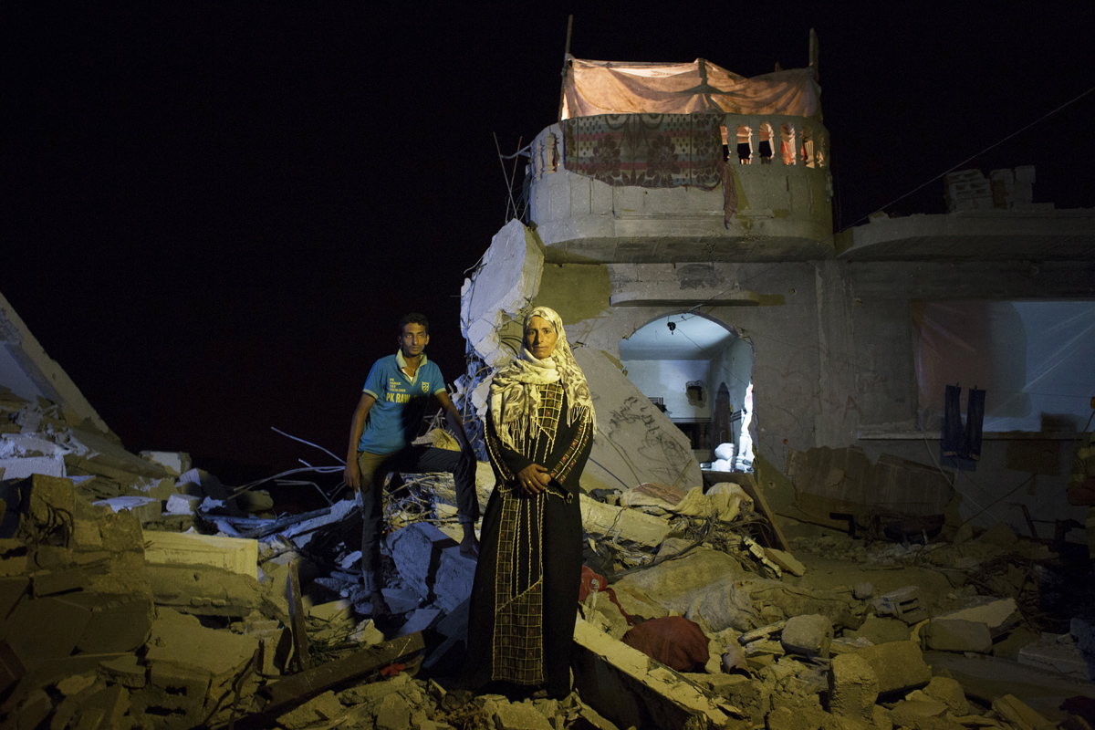 Safia Mohamed Al-Najar, 47, and her 25 year old son Fadi Al-Najar saw their home in Khan Yunis destroyed by artillery and airstrike during the summer's 50-day war between Israel and Hamas. Despite the fact the house is in the dangerous condition, they have to stay, since there is no place else for them to move, or too expensive to do so. And virtually no body has come to help them yet. The son was supposed to marry soon, but it was canceled. Khoza'a in Khan Yunis, Gaza. Oct/10/2014