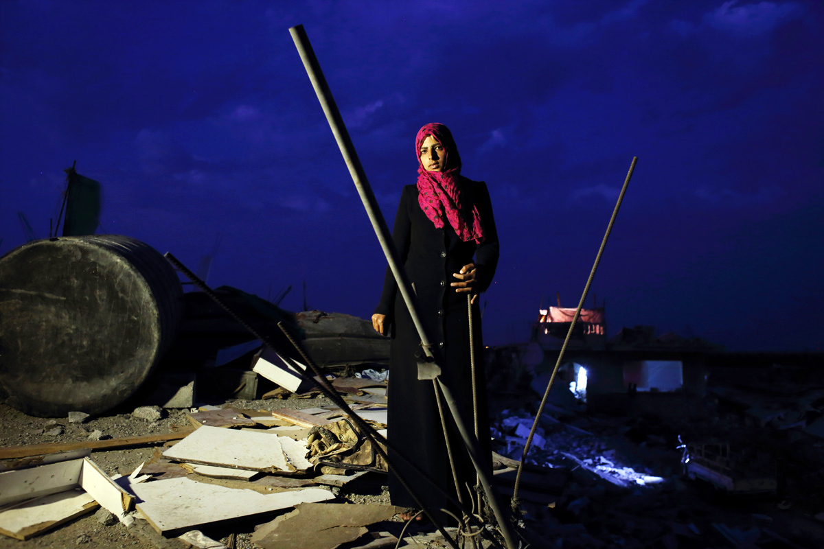 Eman Al-Najar, 23, saw her home in Khoza'a in Khan Yunis destroyed and her brother killed by Israel Defense Forces during the summer's 50-day war between Israel and Hamas. She still stays in a tent with her family on the site of this damaged home. Despite the difficulty, she cannot leave, since there is no other place to move, or too expensive. And virtually nobody has come to help yet. Oct/10/2014