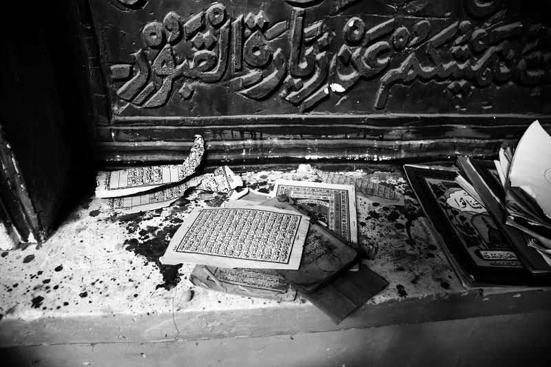 Ripped-off pages of Koran remain at a mosque at Iman Usim tomb site in Taklamakan Desert, Xinjiang, as according to rights groups, the Chinese authority has started to control more religious culture, including prohibition of pilgrimages to the tombs of local saints, especially outside of their communities.