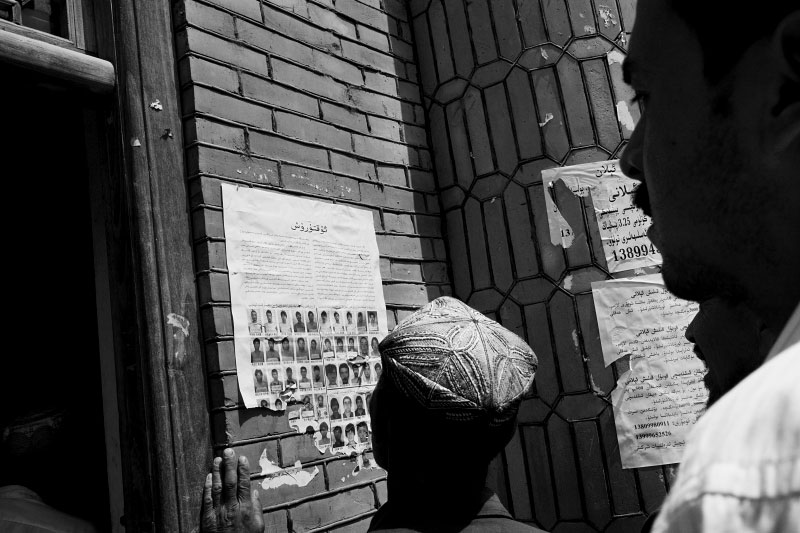 Not wanted, but portraits of the July 5th riot suspects, who were already arrested, are displayed seemingly as warning, at a mosque in Xinjiang. Aug 2009.
