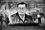 A propaganda mural with Chinese president Hu Jintao is displayed in the street in Tulufan, Xinjiang.