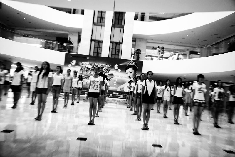 {quote}Xinjiang's Professional Model Contest{quote} is held in a shopping mall in Urumqi, as the Chinese modernization projects or Chinesefication advances in Xinjiang.