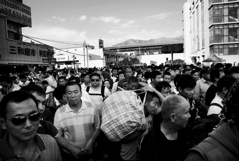 Many Han-Chinese workers or migrants, like these at Urumqi's central railway station, have been flocking into Xinjiang as actors of the Chinese modernization projects or Chinesefication.