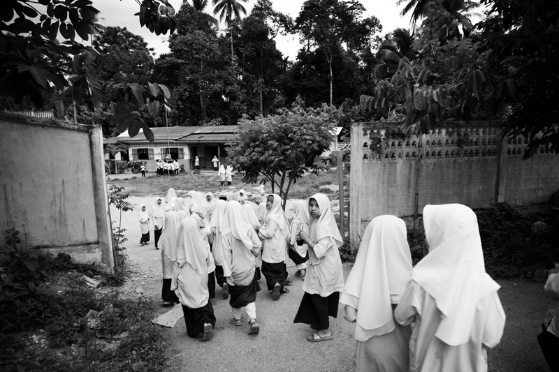 Muslim female students go back to classrooms after the short break of the summer course of a religious school in Yala province in South Thailand where the majority is Muslims and Muslim separate insurgency continues. April 07 2008, Thailand.