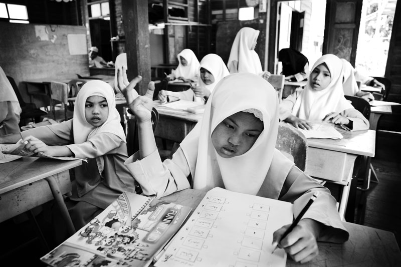 Veiled small Muslim girls take a exam of a summer school in Yala in South Thailand, where the majority is Muslims and the Muslim separate insurgency continues. April 05, 2008, Yala, Thailand.