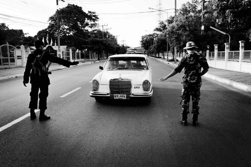 The government soldiers inspect Muslim family's car in Yala in South Thailand where the majority is Muslims and Muslim separate insurgency continues. April 08 2008, Thailand.