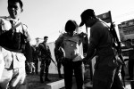 Police and soldiers inspect participants during the Army recruitment at a sport center in Yala in South Thailand where the majority is Muslims and Muslim separate insurgency continues. April 08 2008, Yala, Thailand.