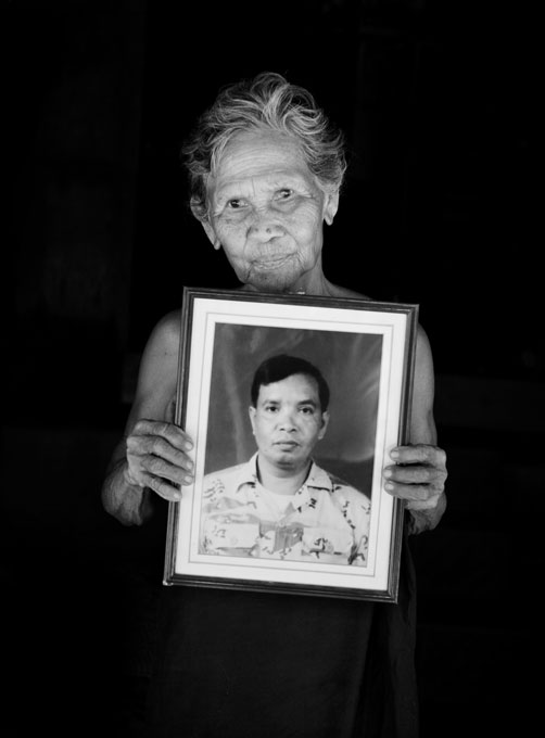 Pin Yomtem, 78, holds a portrait of her Ahoop, 52, who was shot to death allegedly by Muslim insurgents in 2004, in his Buddhist dominated Saicou Village in Narathiwat Province in South Thailand where the majority is Muslims. Due to the strong Buddhism identity of Thailand, many southern Muslims feel themselves in limbo and a certain number of the people look for the independence or joining together with Malaysia. Unfortunately the bloody separate insurgency continues. April 12 2008,