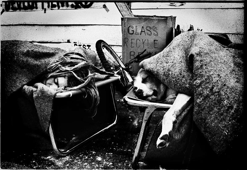 An evicted squatter and his dog spent over night in Avenue A, and little morning snow on them. New York, March 1992.