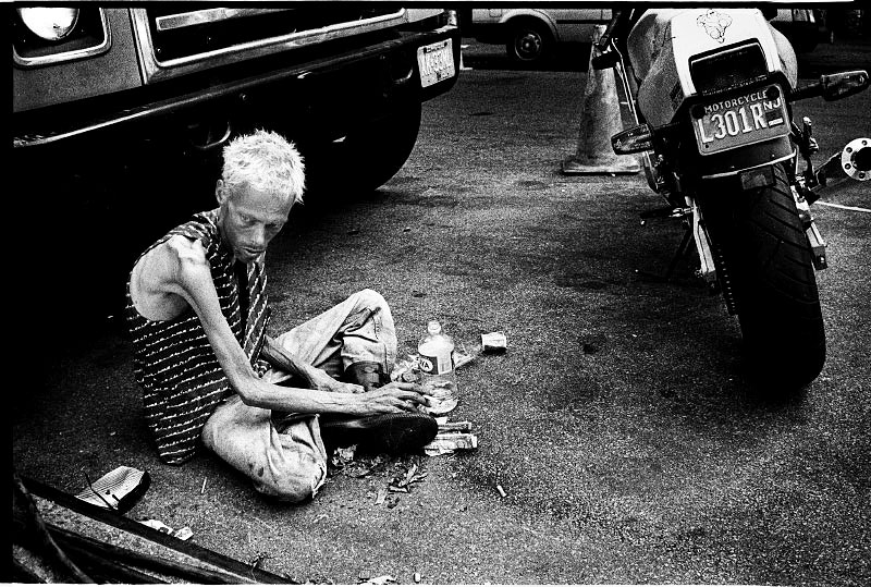 During Wig Stock, or New York's annual drag queen festival, in Tompkins Sq Park, a man allegedly with HIV/AIDS stays at the nearby street. New York, Sep 1993.