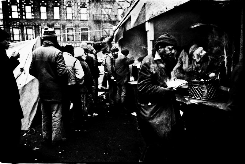 The homeless make a line for food at a soup kitchen at La Plaza in Alphabet City on Christmas. New York, Dec 25 1987.