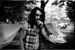 A homeless man smokes cigarette in Tompkins Sq Park, while the so-called tent city, as symbol of resistance, has been established in the park. New York, May 29, 1991.