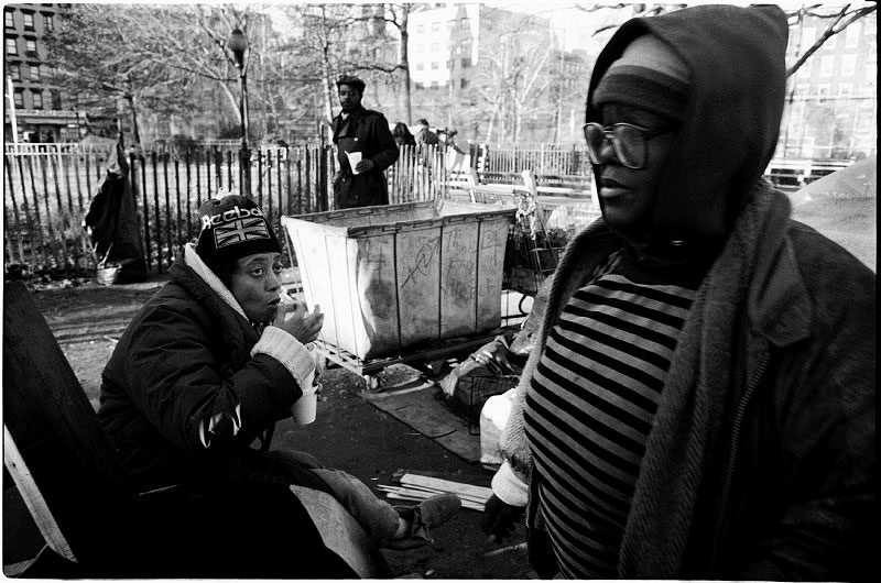 Homeless people in Tompkins Sq Park take soup donated by an aid organization, while fearing the rumor of the coming forceful eviction from the park. New York, Dec 07, 1989.