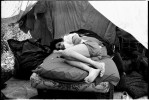 A homeless woman is staying at a bed at an empty lot in Alphabet City. In New York, there is a lack of affordable housing and many homeless do not like to go to shelter due to security and non-privacy reasons. New York, June 1991.