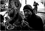 Homeless men take Christmas meal at the soup kitchen of an empty lot called La Plaza. December 25 1987.