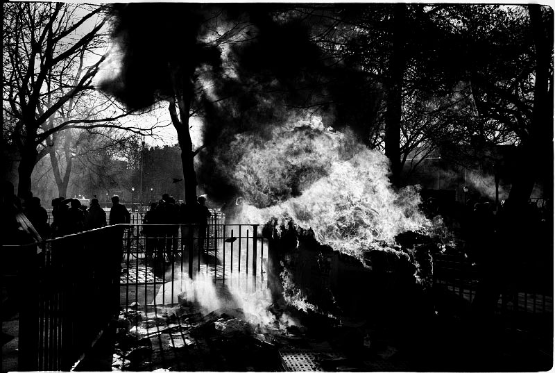 During the forceful eviction of the so-called Tent City in Tompkins Sq Park, some of the homeless residents or outsider activists burn the tents as protest, although other homeless people complain about the burning. New York, Dec 14 1989.