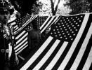 In Tompkins Sq Park, homeless people and supporters camp out under Americanflags to highlight homelessness. New York Aug 1989.
