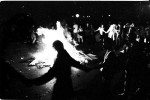Demanding affordable housing, homeless people in Tompkins Sq Park and their supporters wage a protest with a bonfire in Avenue A adjoining to the park. July 1989.