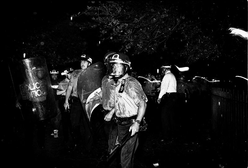 In the Tompkins Square Park, riot-geared police forces are ready to fight protesters. New York, May 27, 1991.