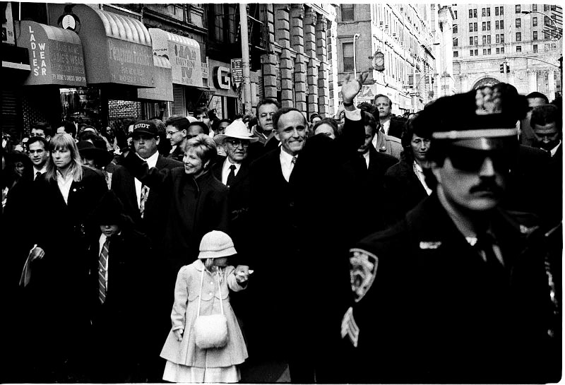 A scene of the inauguration ceremony of New York mayor Rudolf Giuliani, which became a turning point to create radical gentrification in the town. During his terms, the street crimes significantly decreased. On the other hand, police brutality dramatically increased, consequently resulting in the elimination of Tompkins' Tent City movement. January 01, 1994.