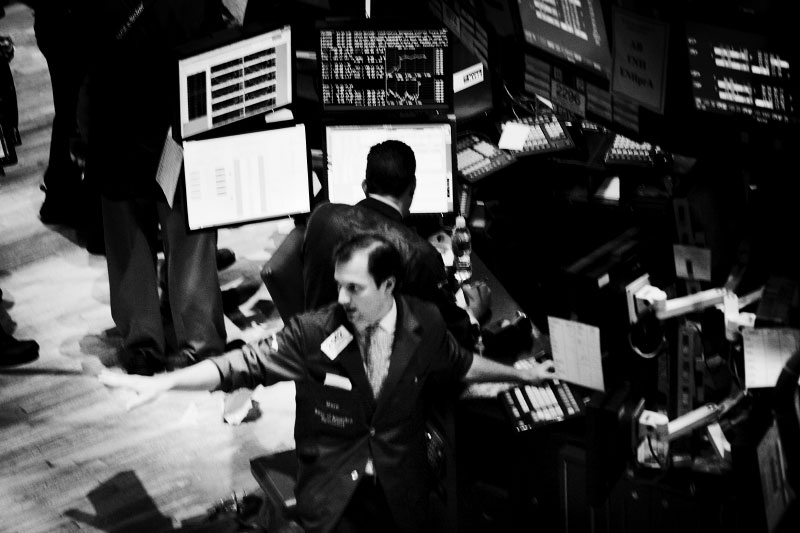 Traders work at the New York Stock Exchange on Friday, the last day of he worst week in at least 75 years at the New York Stock Exchange history. The Dow lost 128 points, giving the blue chips an eight-day loss of just under 2,400, or 22.1 percent. The Dow once fell below 8,000 on Friday, although it was a relatively mild loss at the end. New York, Oct 10 1008.