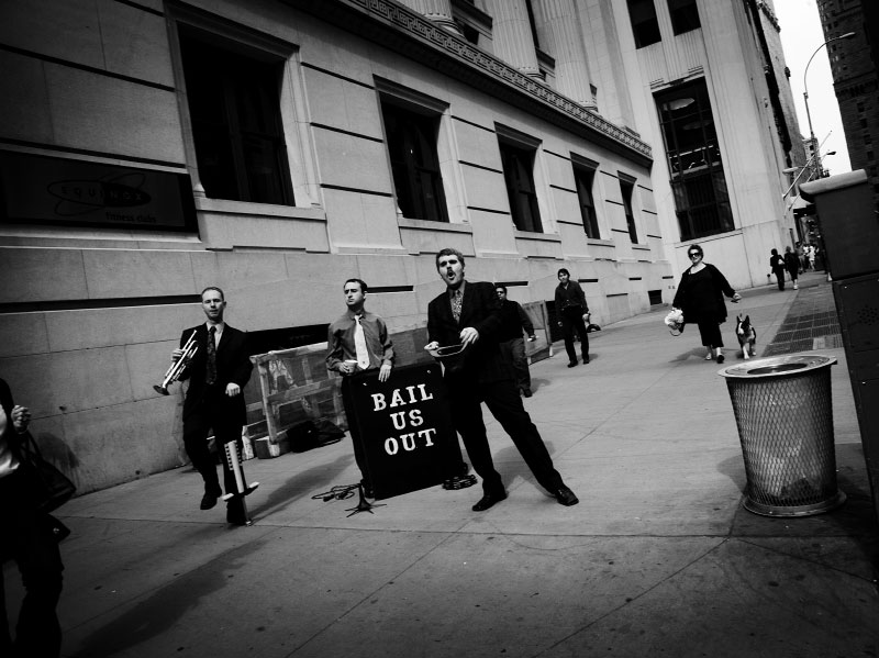 Cynical street performers at Wall street area, as  the current financial crisis or economic melt-down still continues. New York, Oct 13 2008.