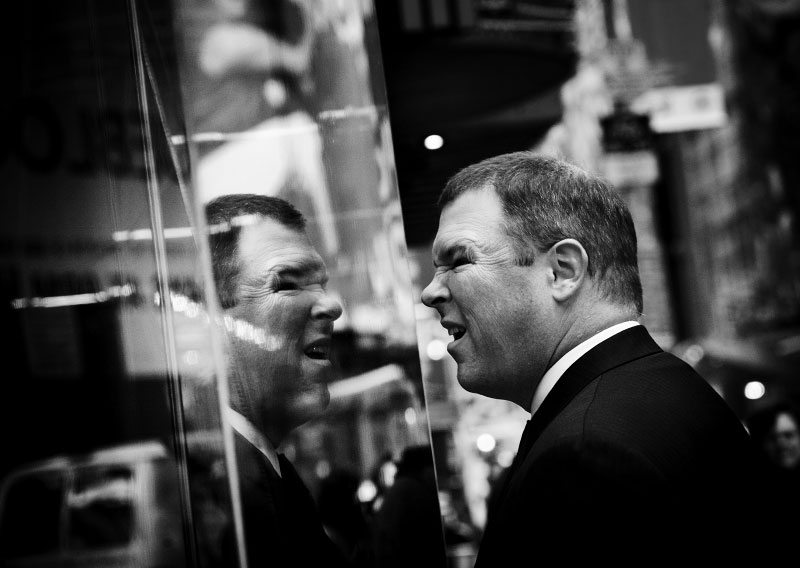A man watches the financial news at the Nasdaq site in the Times Square, as Wall Street suffers through another extraordinary and traumatic session Monday, and people of the Main Street also start to worry about the impact. The Dow Jones industrials plunged as much as 800 points -- their largest one-day point drop -- before recovering to close with a loss of 370, resulting in the Dow below 10,000 for the first time in four years, despite the US and other states' government efforts to contain the fast-spreading financial crisis. New York, Oct 06 2008.