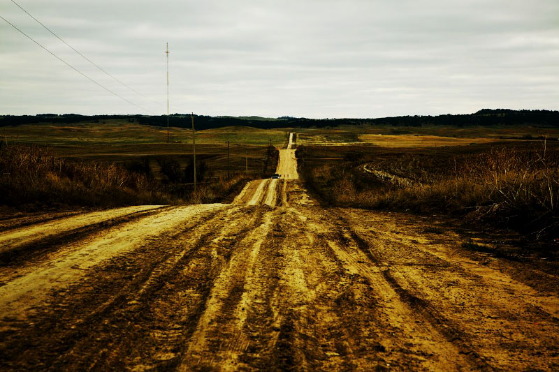 A desolate scene of Pine Ridge reservation where there is no industry and its Native American life spans is very short compared to other Americans, due to health problems causes by cancer, heart attack, diabetes, alcohol, and high rate homicide. However, most problems have been ignored by the federal, state, and even local tribal governments.