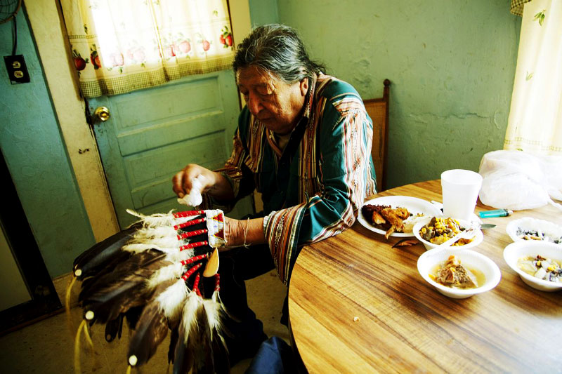 Noah Noleaf, a 81 year old Lakota chief, is taking care of his pride, the hair decoration as chief, as the Lakota communites have been deteriorating.