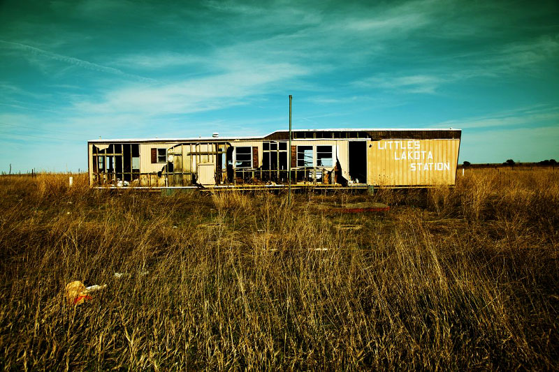 A scene of an abandoned trailer house, as storm often destroys houses in the Pine Ridge reservation.