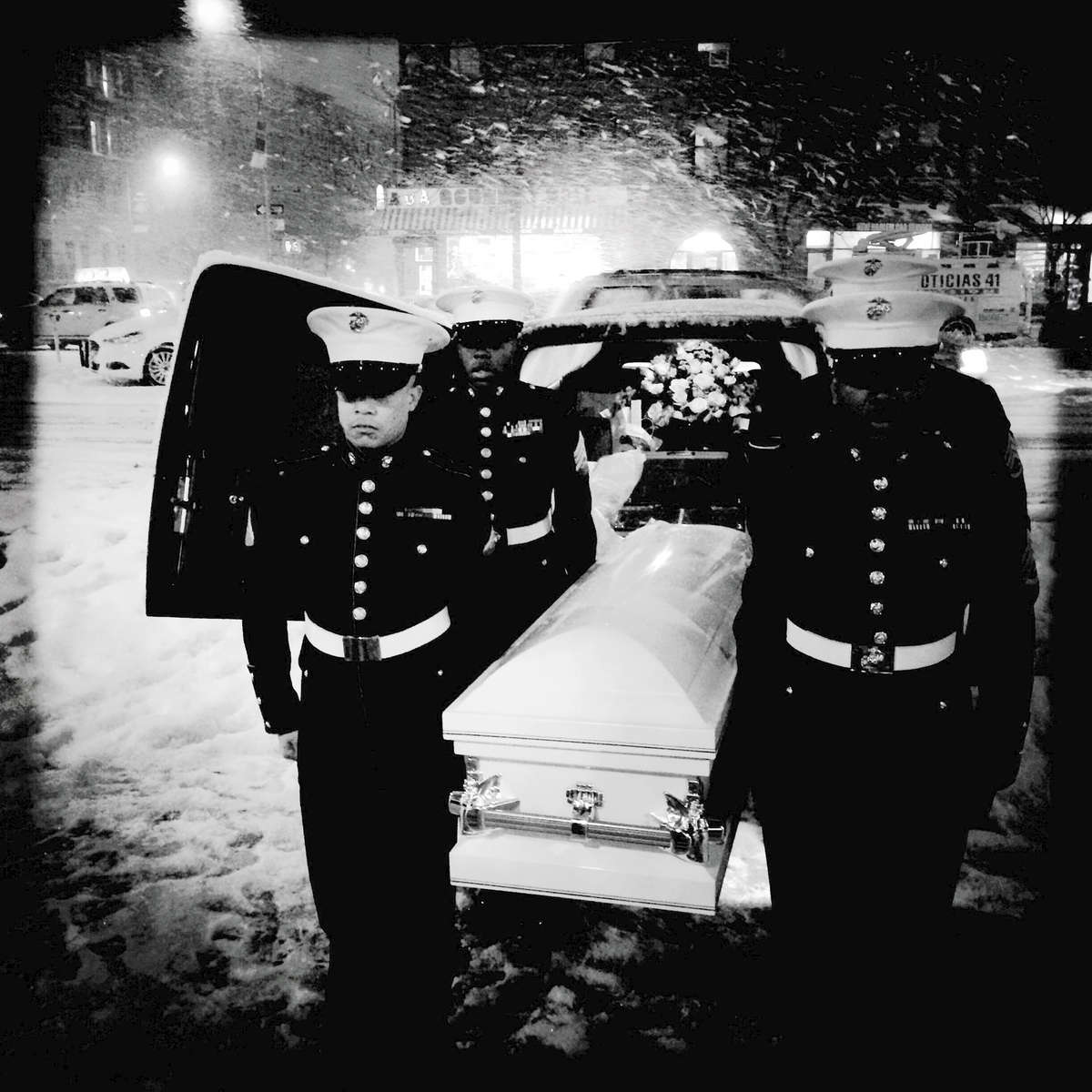Funeral at the First Corinthian Church -- Harlem.During a heavy snow storm, members of the Harlem Youth Marines carry  out Myls Dobson's coffin from a car during the 4-year-old's funeral at the First Corinthian Church.