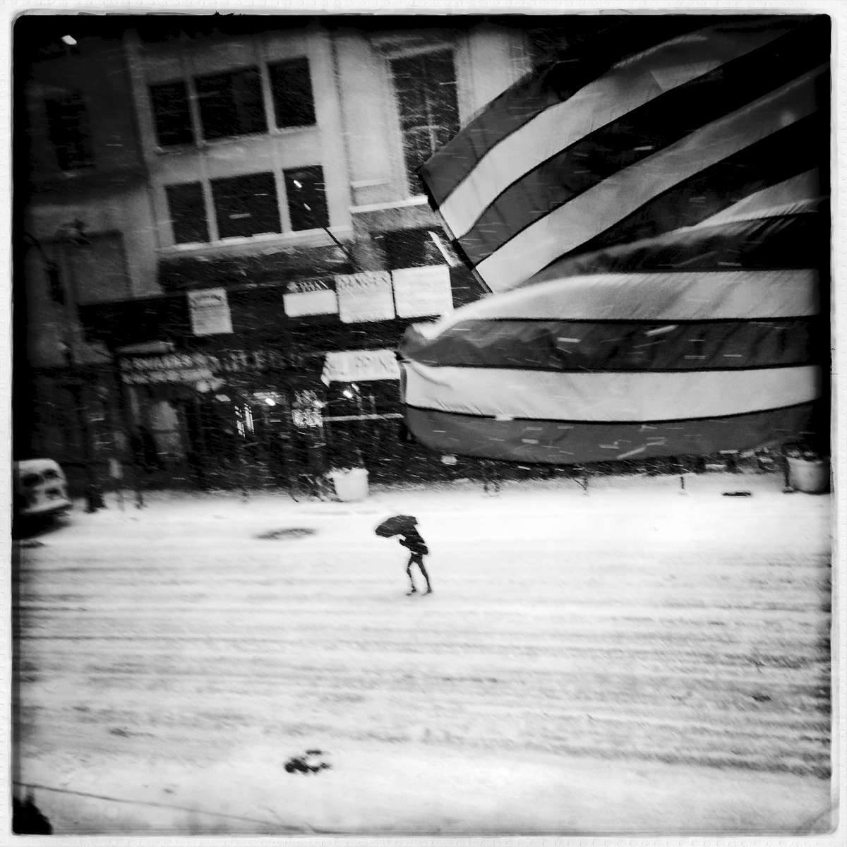A woman in the middle of 5th Avenue, during blizzard due to Polar Vortex.