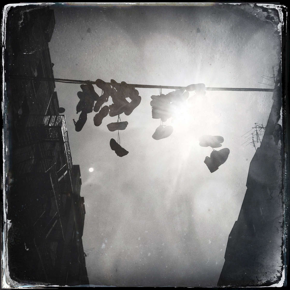 Shoes dangling in an alley -- South Bronx, Aug. 2013.