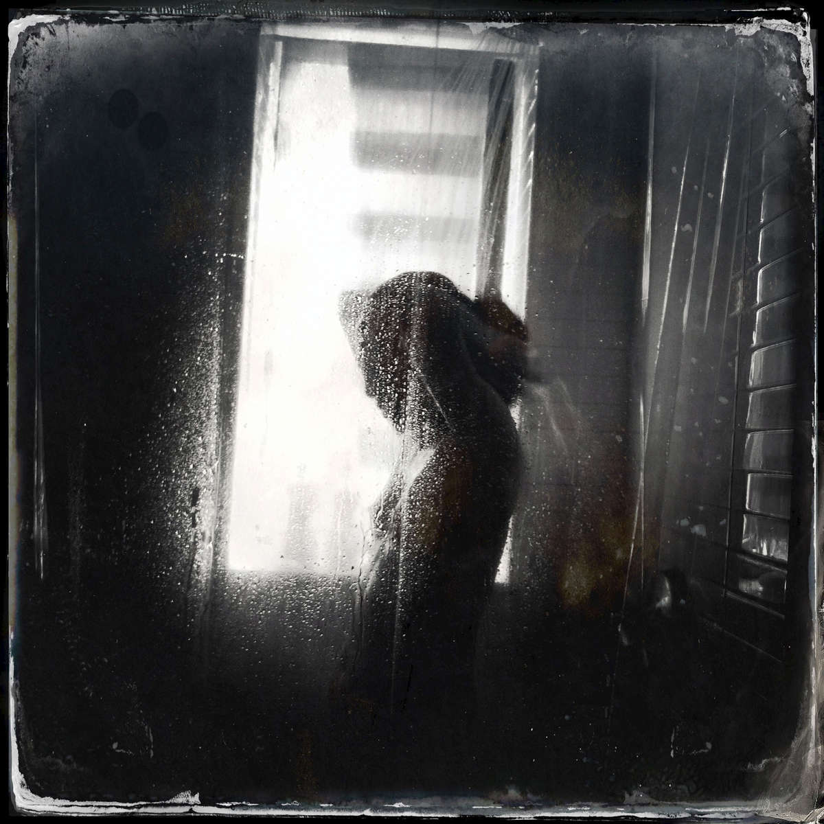 Silhouette in shower -- Harlem, Sep. 2013.