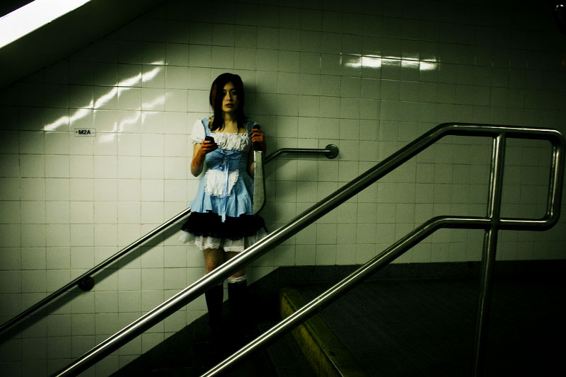 A girl stands at 14th street subway station on 8th Avenue on the Halloween night, expecting the long, wild night.